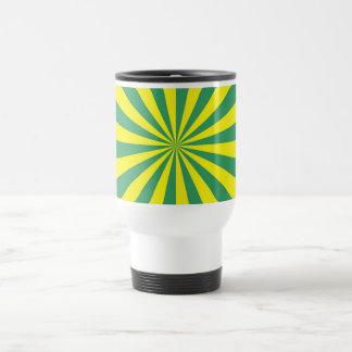 Rayos de sol en taza verde y amarilla