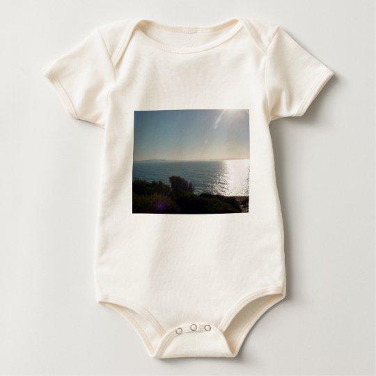 Rayos de Sun en el océano Body Para Bebé