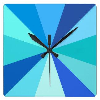 Rayos geométricos enrrollados modernos 60s del reloj cuadrado