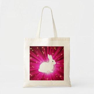 Rayos ligeros coloridos y conejito blanco bolsa