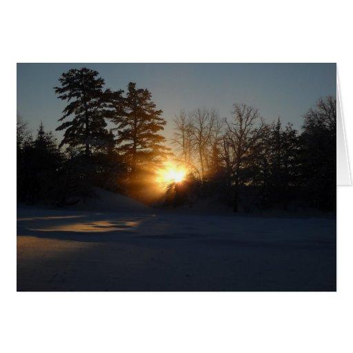 Rayos ligeros de la salida del sol de enero tarjeta de felicitación