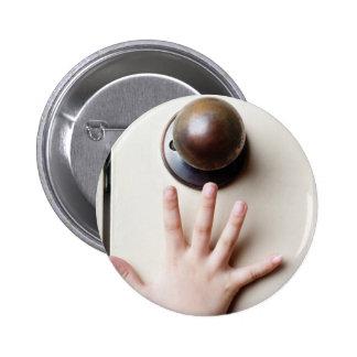 Reaching for door knob 2 inch round button