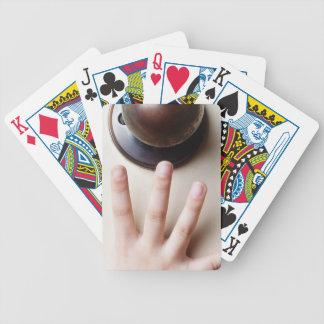 Reaching for door knob bicycle poker deck