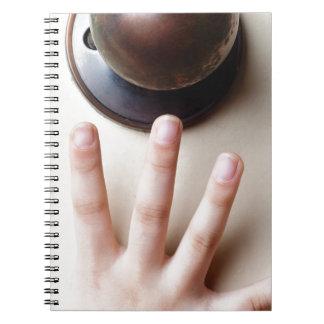 Reaching for door knob spiral notebook