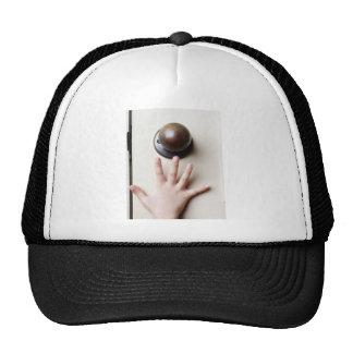 Reaching for door knob trucker hat