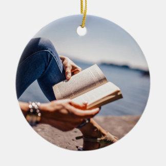 Reading A Book At The Lake Ceramic Ornament