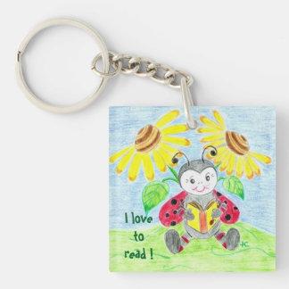 Reading ladybug acrylic keychain