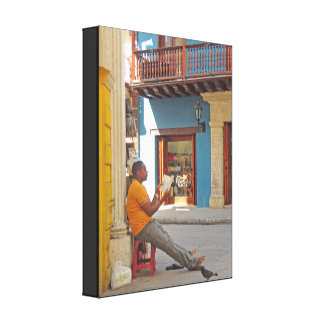 Reading on the Street in Cartagena Colombia Canvas Print