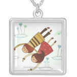 Rear view of a couple flying together square pendant necklace