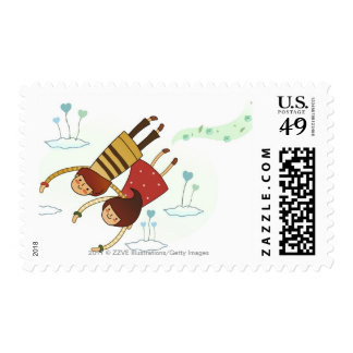Rear view of a couple flying together postage stamps
