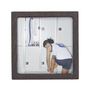 Rear View of a Female Volleyball Player Tying Keepsake Box