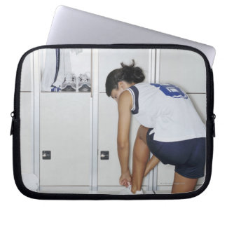 Rear View of a Female Volleyball Player Tying Laptop Sleeve