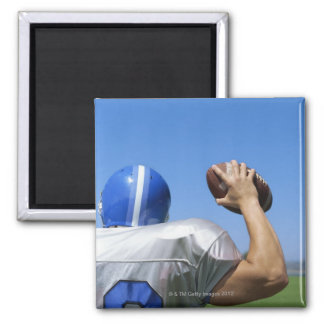 rear view of a football player throwing a 2 inch square magnet