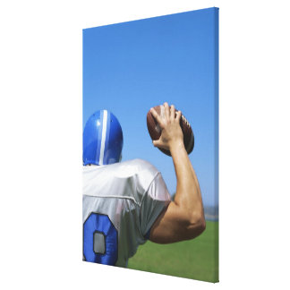 rear view of a football player throwing a canvas print