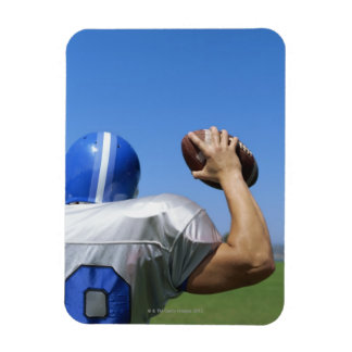 rear view of a football player throwing a magnet