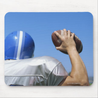 rear view of a football player throwing a mouse pad