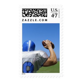 rear view of a football player throwing a postage stamp