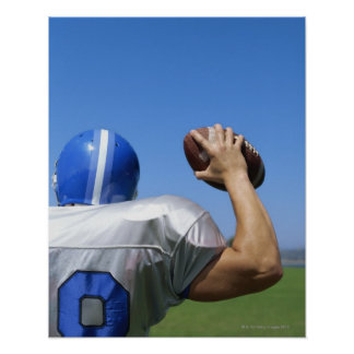 rear view of a football player throwing a print