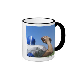 rear view of a football player throwing a ringer mug