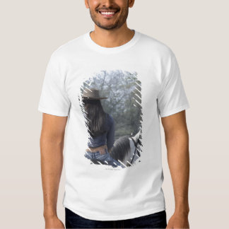 Rear view of a woman riding a horse tshirt