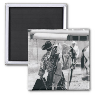 Rear view of cowboy hauling gear 2 inch square magnet