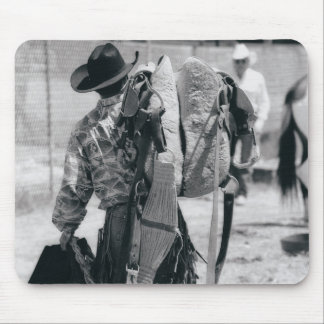 Rear view of cowboy hauling gear mouse pad