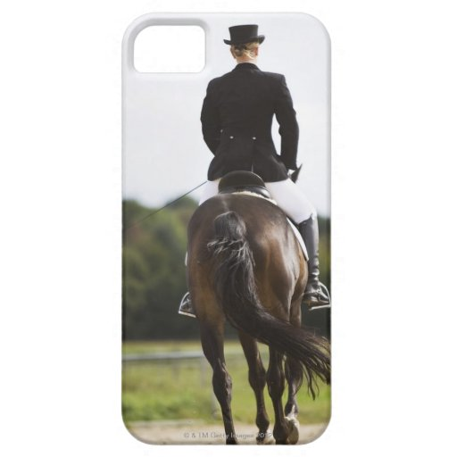 rear view of female dressage rider exercising blackberry bold covers