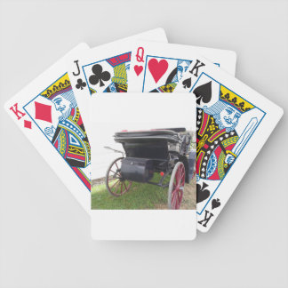 Rear view of old-fashioned horse carriage on green bicycle playing cards