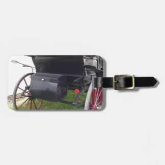 Rear view of old-fashioned horse carriage on green luggage tag
