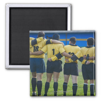 Rear view of rugby team standing with their arms refrigerator magnet