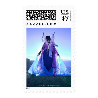 Rear view of woman wearing fairy costume postage