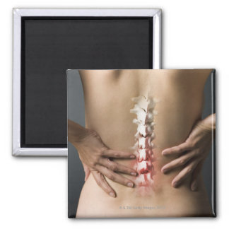 Rear view of woman with hands on back and sore 2 inch square magnet
