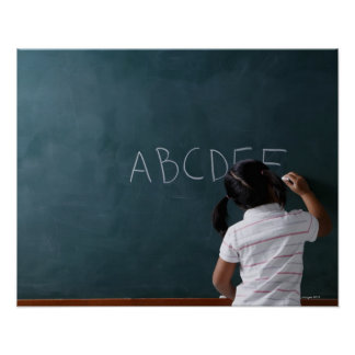 rear view of young girl writing on chalk board poster