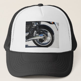Rear wheel and chromed exhaust pipe of motorcycle trucker hat