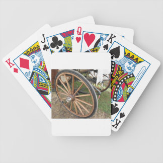 Rear wheels of old-fashioned horse carriage bicycle playing cards