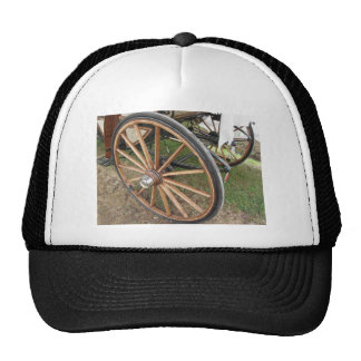 Rear wheels of old-fashioned horse carriage trucker hat