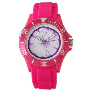 rebanada anaranjada enrrollada púrpura reloj de mano
