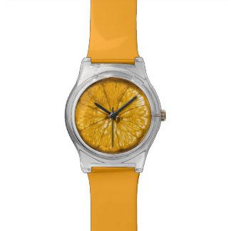 Rebanada anaranjada jugosa relojes