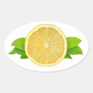 Rebanada de limón con las hojas pegatina ovalada