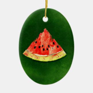 Rebanada de sandía en fondo verde adorno navideño ovalado de cerámica