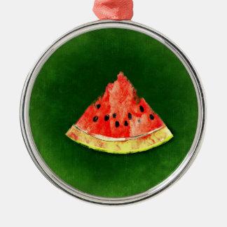 Rebanada de sandía en fondo verde adorno navideño redondo de metal