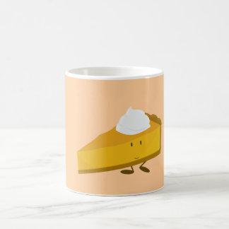 Rebanada sonriente de pastel de calabaza tazas