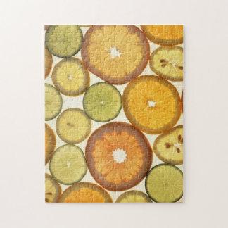 Rebanadas anaranjadas de la fruta del pomelo de la puzzles con fotos