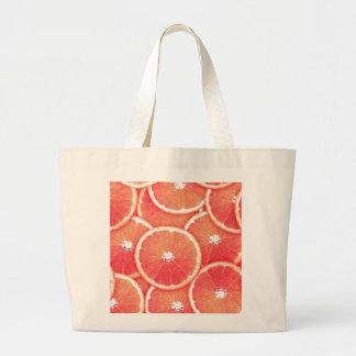 Rebanadas del pomelo rosado bolsa tela grande