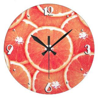 Rebanadas del pomelo rosado reloj redondo grande