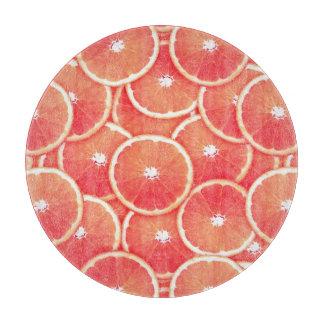 Rebanadas del pomelo rosado tablas para cortar
