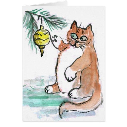 Rechoncho, el gatito, golpea ligeramente un tarjeta de felicitación