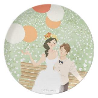 Recienes casados en una rama del jardín platos