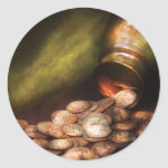 Recogida de moneda pegatina redonda
