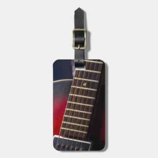 Recogida roja de la guitarra de HollowBody del cue Etiqueta De Equipaje
